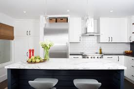 shaker cabinets white kitchen midcentury with wood floor subway