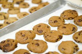 Baking Fresh Homemade Chocolate Chip Cookies On Tray Фотография