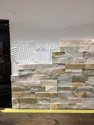 how to install stacked tile on a fireplace wall