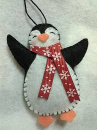 this item is a handmade felt penguin ornament it is