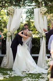 Like Fabric Arch Off The Porch Ceiling For Wedding This Is A Simple