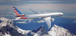 American Airlines plane over mountains featured