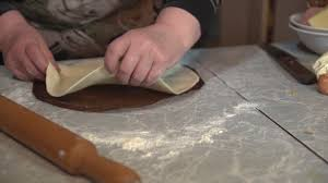 A Brunette Woman Makes Pizza Dough On Light Kitchen Table At Home Close