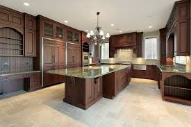 Dark Rich Wood Tones Really Stand Out In This Light Kitchen Featuring Tile Flooring And Green