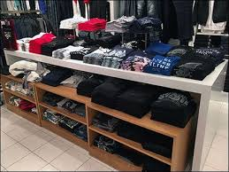 Even A Department Store Can Take Advantage Of The Mass Universal Appeal T Shirts Here Space Enough Is Outfitted And Configured Via Display Table
