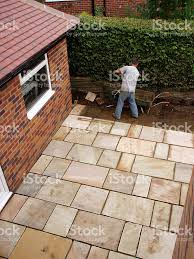 Patio Slabs by Man Laying Patio Paving Slabs In House Garden Stock Photo