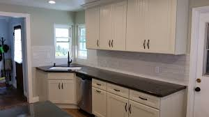 dove white cabinets with bead boarding backsplash is handcrafted