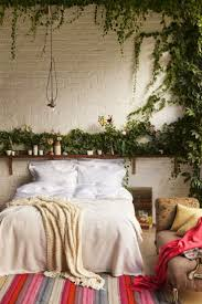 A Minimal Bedroom Feels Au Naturale With Leafy Decor Whether Its Hanging From The Walls