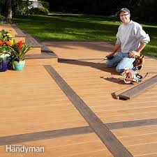 how to build a deck a concrete patio family handyman