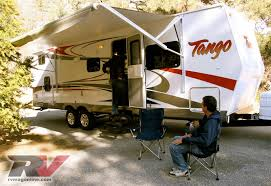 Tango Travel Trailer - Features - RV Magazine Dometic 9000 Plus Patio Awnings Rv Camping Trailer Awning Vintage Spartan Manor With Large Never Used 2h Fully Enclosed 7 Foot Dressing Room Amazoncom Recpro Camper Motorhome Travel 20 White Oztent Foxwing For Teardrop Youtube How To Use The Power By Lakota Trailers Rockwood Geo Pro Small Enthusiast Build Your Lance Lights Rv For Magazine Image Flying Cafree Ju158e00 Replacement Fabric 15 Ocean Blue Repair Controls