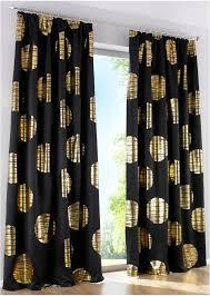 edler verdunkelungsvorhang mit goldenem druck schwarz gold