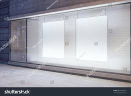 Blank White Posters In The Window On Night Empty City