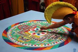 A Buddhist Monk Creating Mandala