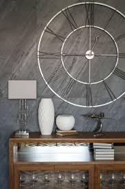 design wanduhr metall modern silber