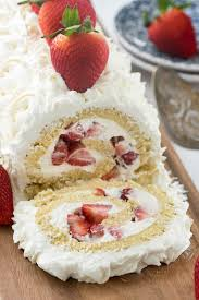 Strawberry Shortcake Cake Roll this easy strawberry shortcake filled with cream cheese whipped cream