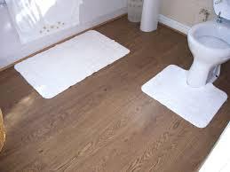tiles bathroom toilet white bathroommat wooden laminate flooring