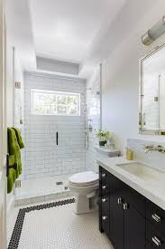black washstand with white hex tiles transitional bathroom