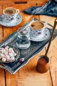 Turkish Coffee Served In A Traditional Cup On Copper Tray Photographed With Glass