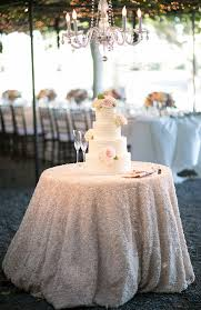 Elegant Wedding Cake Table With White Rosette Linen