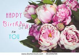 Happy Birthday text card with pink Peony flowers Blue background