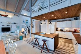 Blue Cottage Kitchen With Wood Counter Island At Beach House Loft