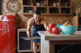 mann in schürze kochen gebäck auf der küche foto nomadsoul1 auf envato elements