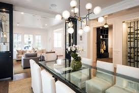 Modern Dining Room Design With Glass Table White Chairs And Sputnik Chandelier