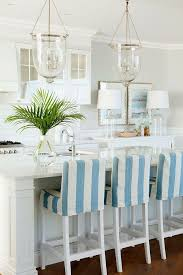 Coastal Kitchen With Bell Jar Lantern Pendants Strip Slicovered Barstools White Marble Countertop