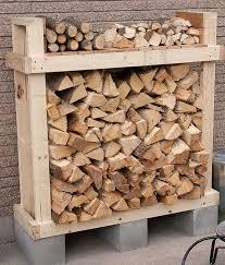 9 super easy diy outdoor firewood racks the garden glove