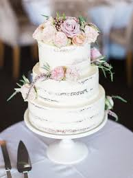 Rustic Buttercream Wedding Cake With Peach And Pink Flowers